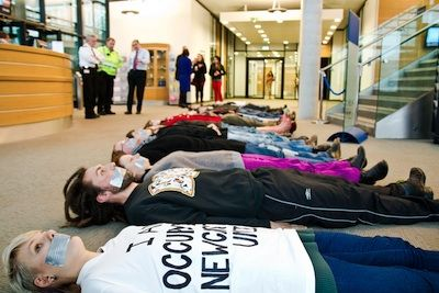 Protesters at Newcastle University lay on the floor in the entrance of the Fine Arts building with their mouths taped up, symbolizing the frustration and anger they feel at being excluded from talks about the impact that cuts to higher education will have on the university. PHOTO: Newcastle University Occupation