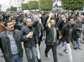 Tunisians march in Tunis for bread and an end to the reign of a dictator. PHOTO: Nasser Nouri