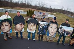 The UAW will attempt to shame Asian- and German-owned automakers into remaining neutral as the union tries to organize their plants in the U.S. In December UAW members demonstrated near Detroit in support of Korean workers striking Hyundai. Photo: Jim West.