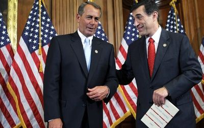 Speaker of the House Rep. John Boehner (L) with Rep. Darrell Issa during the ceremonial swearing-in. PHOTO: Getty Images/Alex Wong
