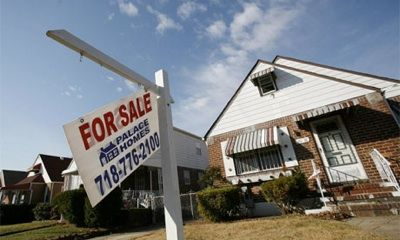If house prices fall by 15% in 2011, the likely cut in consumer spending could cost 1% in GDP. PHOTO: Reuters/Shannon Stapleton