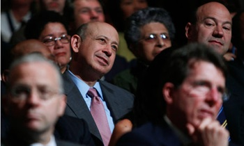 Goldman Sachs's chief executive, Lloyd Blankfein, looks unworried as he listens to a speech by President Obama on banking reform last year. Photograph: Jim Young/Reuters