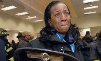 Several hundred Camden, New Jersey firefighters and police officers were laid off, 18 January 2011: Renee Muhammad, who is one of four women firefighters in Camden, gets emotional while waiting to hand in her gear. PHOTO: April Saul/Philadelphia Inquirer/MCT