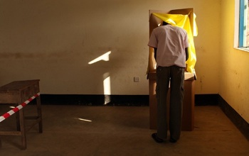 A man votes during the first day of voting for the independence referendum in Sudan.  PHOTO: Getty Images/Spencer Platt