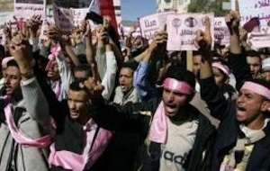 Opposition supporters shout slogans during an anti-government rally in Sanaa January 27, 2011. Thousands of Yemenis took to the streets of Sanaa on Thursday to demand a change of government, inspired by the unrest that has ousted Tunisia's leader and spread to Egypt this week. (REUTERS/Khaled Abdullah)