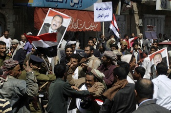 Clashes broke out between groups supporting and opposing the government in Sanaa on Saturday. PHOTO: Reuters