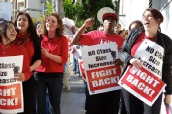 Los Angeles teachers rallied against class size increases and layoffs at a school board protest last year. Union members are fighting to center schools around social justice, fund them fully, and develop teachers in a pro-union environment. PHOTO: David Rapkin.