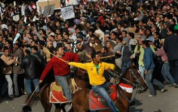 Supporters of embattled Egyptian President Hosni Mubarak ride horses through the melee during a clash between pro- and anti-Mubarak protesters on February 2 in Tahrir Square in Cairo, Egypt. (Chris Hondros/Getty Images)