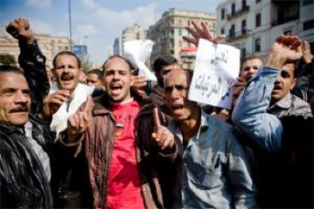 Striking telecommunication workers attend mass protests in Cairo's Ramses Square. PHOTO: Hossam el-Hamalawy