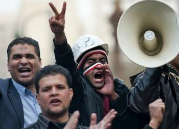 Demonstrators continued a blockade around the parliament building in Cairo. PHOTO: Pedro Ugarte/AFP
