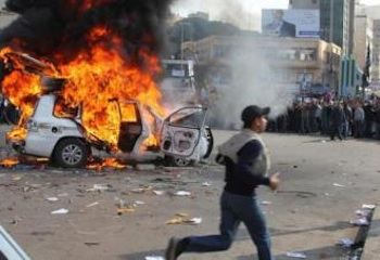 A car burns in the middle of the street as Libyans continue their mass protests against dictatorship. PHOTO: SocialistWorker.org