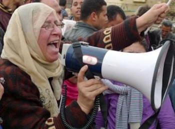 A woman leads chants against Hosni Mubarak in Tahrir Square. PHOTO: Joseph Hill