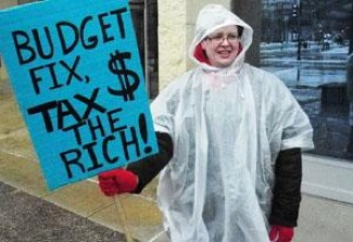 A protester in Madison has the answer to the state's budget shortfall. PHOTO: Peter Patau.
