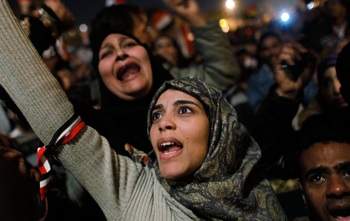 A woman cheers in Tahrir Square after it is announced that President Hosni Mubarak was giving up power February 11, 2011 in Cairo, Egypt. PHOTO: Chris Hondros/Getty Images