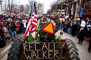 Hundreds of farmers drove to the Wisconsin capital on March 12 to protest Walker's