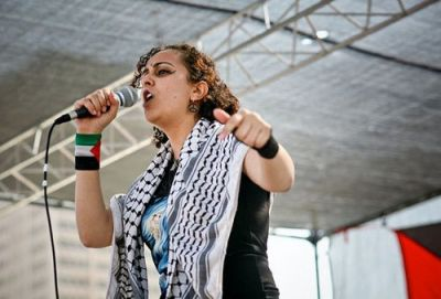 Palestinian R&B singer Sabreena da Witch writes songs that combine the personal and the political.  PHOTO: New America Media
