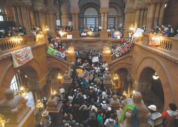 On March 31, a broad coalition of protesters, which include teachers, students, New York City renters and health care advocates, gathered in Albany to speak out against state budget cuts. PHOTO: The Troy Record