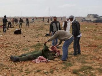 Libyans survey the damage and casualties from U.S.-led bombing. Photo: SocialistWorker.org