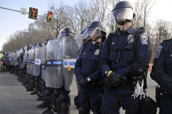 THE NOT-SO-THIN BLUE LINE: Virginia State troopers in riot gear move in on demonstrators. PHOTO: Ellen Davidson