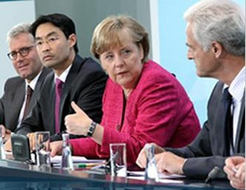 German Chancellor Angela Merkel announces the new policy with members of her government. PHOTO: Courtesy Office of the Chancellor.