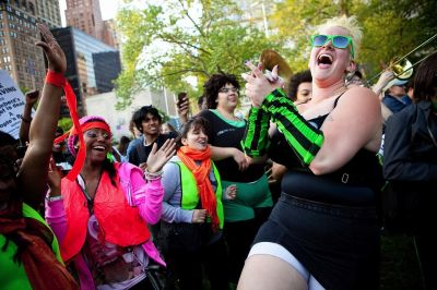 A woman dances at the end of the protest. PHOTO: Andrew Stern