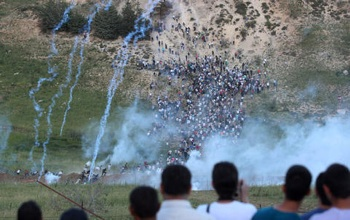 Israeli forces fired tear gas and live ammunition at demonstrators approaching the occupied Golan Heights from Syrian-controlled territory. PHOTO: Atef Safadi/Newscom