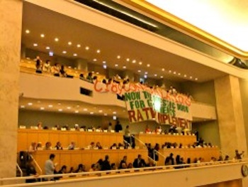 Members of the Domestic Workers Alliance drop a banner at the ILO Convention. PHOTO: idwnilo.com