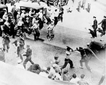 Violence breaks out between Minneapolis police and Teamsters in June 1934, during a city-wide strike.  PHOTO: The National Archives