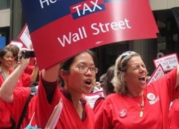 """Nurses rallied on Wall Street in downtown Manhattan. The bankers should be happy that unions are calling for a transaction tax """"because some us would like them to make restitution,"""" said Jean Ross, a Minnesota nurse. PHOTO: Jenny Brown"""