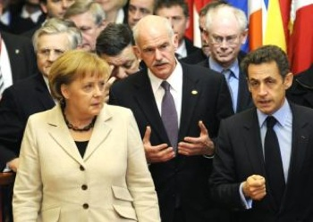 From left: German Chancellor Angela Merkel, Greece's Prime Minister George Papandreou and French President Nicolas Sarkozy leave an EU summit (John Thys | AFP)