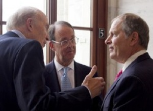 David Cote (far right), CEO of Honeywell International Inc., chats with Alan Simpson and Erskine Bowles, co-chairs of President Obama's deficit commission. CREDIT: Andrew Harrer/Bloomberg/Getty Images