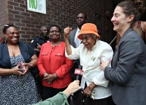 Mary Lee Ward emerges from a New York City courtroom after learning her eviction was halted.