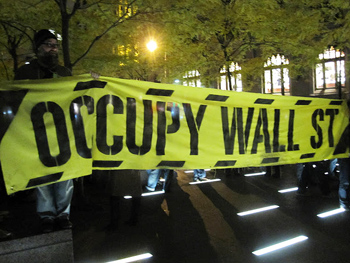 At 6:30 p.m. Protesters officially re-entered Zuccotti Park, which was completely surrounded by metal fences. (Photo: Nikki Saint Bautista)