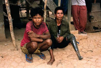 Two victims of cluster munitions in Ta Oy Province, Laos. (Photo: John Rodsted)