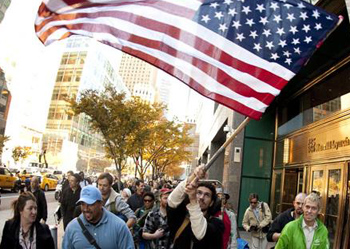 Occupy Wall Street protesters pass the World Financial Center on November 9, 2011, in New York. The group began a two-week march to Washington D.C. that day. (Photo: Don Emmert/AFP/Getty Images)