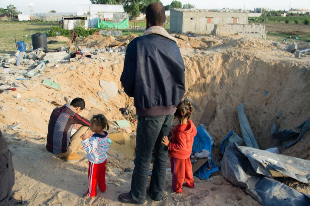 walid_al_nassasra_stands_next_to_the_former_home_of_his_brother_near_rafah.jpg